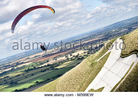 Glider soars over Westbury White Horse Wiltshire - Stock Photo