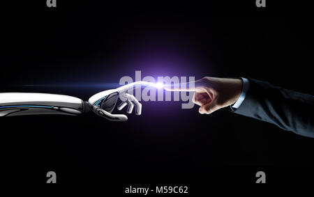 robot and human hand connecting fingers - Stock Photo
