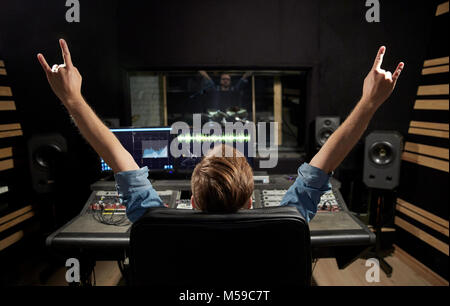 man at mixing console in music recording studio - Stock Photo