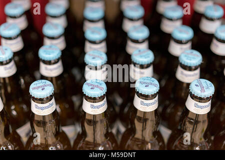 Kiev, Ukraine. February 18 2018. Hoegaarden beer bottles on store shelf. Hoegaarden Brewery is a brewery in Hoegaarden, - Stock Photo