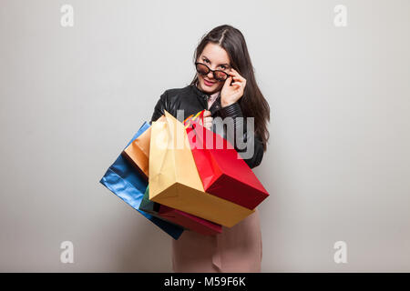 Attractive model takes glasses off to see with her eyes - Stock Photo