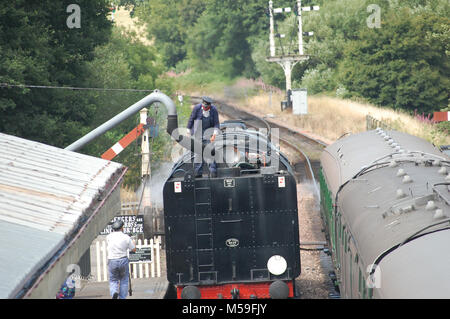92212 taking on water at The Bluebell Railway - Steam train preservation in Sussex running from Sheffield Park to - Stock Photo