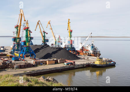 Anadyr, Chukotski region, Russia - Anadyr, August 23, 2017: Seaport, the coal terminal, with the ships standing - Stock Photo