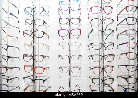 Rack with spectacle frames in an optician's shop - Stock Photo