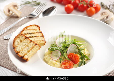 mashed potatoes on white wooden background - Stock Photo