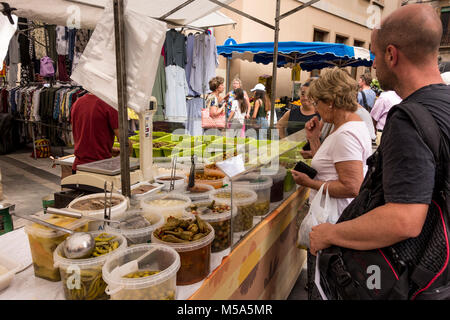 Stall selling various types of olives picked vegetables at weekly market in La Bisbal d'Emporda, Baix Emporda, Catalonia,Spain - Stock Photo