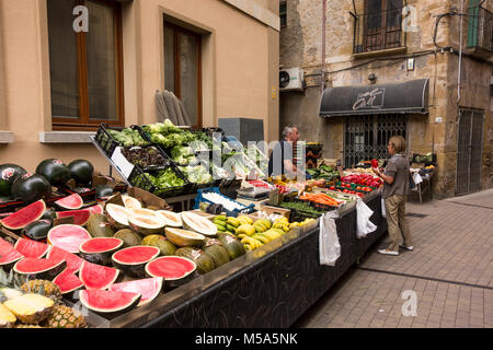 Stall selling fruits and vegetables at weekly market in La Bisbal d'Emporda, Baix Emporda, Catalonia, Spain - Stock Photo
