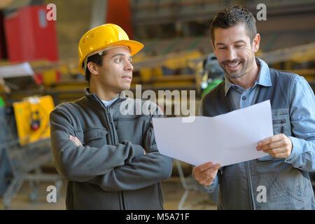 supervisor reading the happy news - Stock Photo