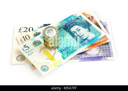 UK money - New issue £20 £10 and £5 pound notes Sterling close up with a stack of new 2017 design £1 one pound coins - Stock Photo