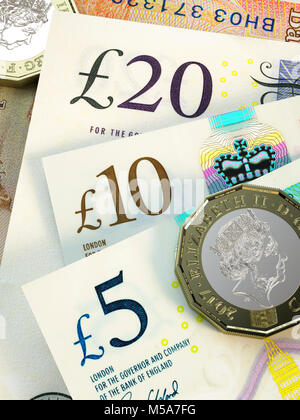 UK money - New issue £20 £10 and £5 pound notes Sterling close up with new 2017 design £1 one pound coins - Stock Photo