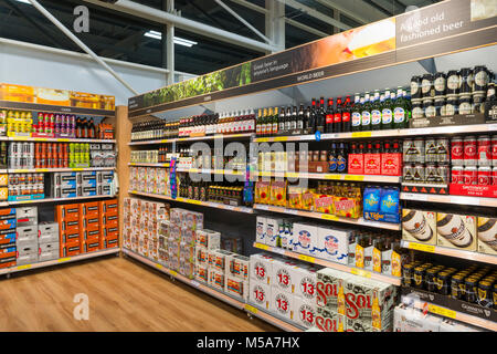 Beer, lager, cider and other alcohol on sale in a supermarket, UK - Stock Photo