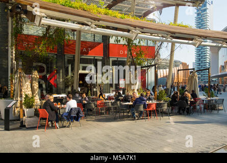 People at a street cafe in the Porta Nuova, Milan, Italy - the central business district - Stock Photo