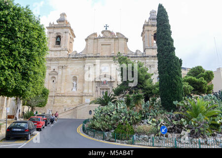 Vittoriosa, Malta - 31 October 2017: people walking in front of the Collegiate church of St Lawrence at Vittoriosa - Stock Photo