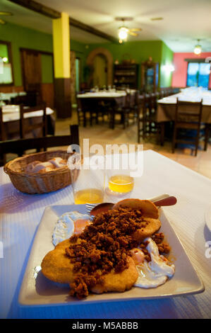 Fried eggs with tortos and picadillo, typical Asturian dish. Asturias, Spain. - Stock Photo