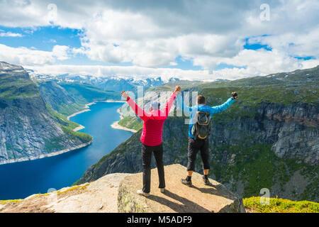 Couple posing on Trolltunga Norway - Stock Photo