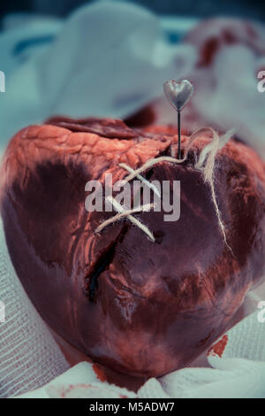 A mended broken heart - stitched - Stock Photo