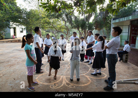 Pupils play before a Mayan mathematics class at Ignacio Ramirez Calzada primary school in indigenous Celtun community - Stock Photo