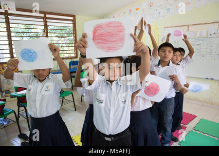Pupils attend a Mayan mathematics class at Ignacio Ramirez Calzada primary school in indigenous Celtun community - Stock Photo
