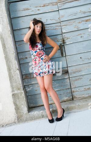 Young woman legs heels skimpy clothing alpfabet - Stock Photo