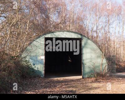 old unused bunker door way shed outside land; essex; england; uk - Stock Photo