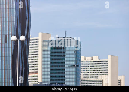 Conglomerate of modern architecture buildings in Vienna Danube City. from left to right DC Tower, Tech Gate, UNO - Stock Photo