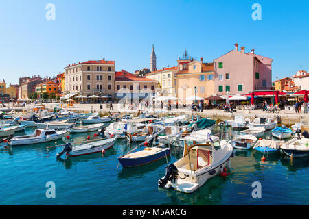 Beautiful and cozy medieval town of Rovinj, colorful with houses and church the harbor in Croatia, Europe - Stock Photo