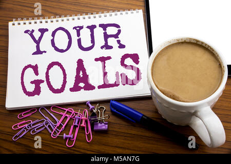 Hand writing text caption inspiration showing Your Golas. Business concept for Goal Achievement written on note - Stock Photo