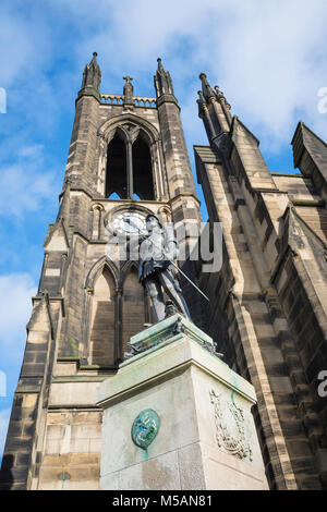 Newcastle church,view of the tower of St Thomas The Martyr Church with  its war memorial statue of St George in - Stock Photo