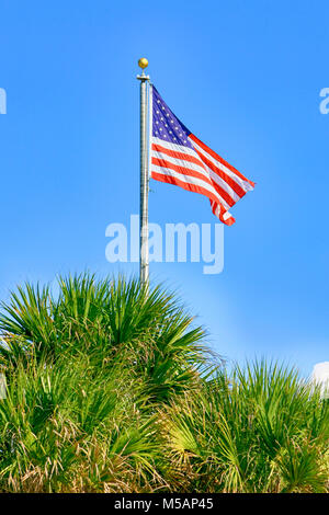 American flag wafts gently in the sea breeze at Boca Grande on Gasparilla Island FL, USA - Stock Photo