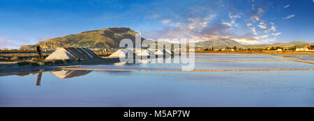 Pictures & images of Pile of sea salt on the edge of the salt pans of the World Wildlife reserve of Saline di Trapani - Stock Photo