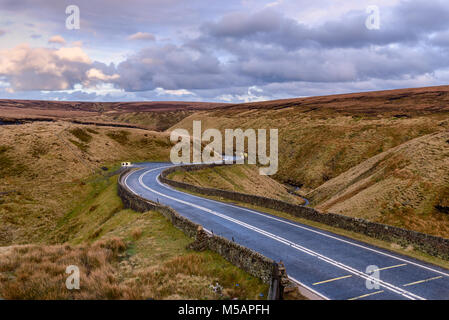 Picture of Winding road leading through a beautiful rugged landscape, North west England. - Stock Photo