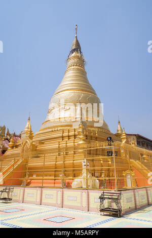Golden stupa at the Soon U Ponya Shin Pagoda on the Sagaing Hill in Mandalay, Myanmar (Burma) on a sunny day. - Stock Photo