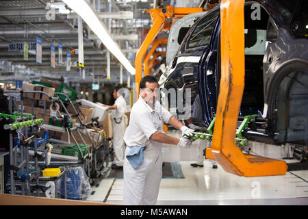 A worker in the golf vehicle section of the Volkswagen factory in Puebla, Mexico on Wednesday, January 21, 2015. - Stock Photo