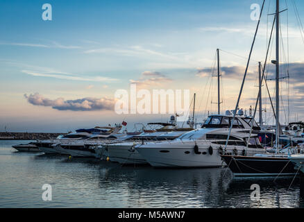 Sunset at Puerto Banús, a marina located in the area of Nueva Andalucía, in Andalusia, Spain. - Stock Photo