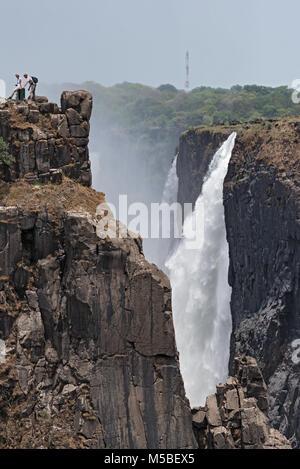 Tourists at the Victoria Falls, Zimbabwe, Zambia, Africa - Stock Photo