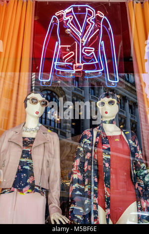 Buenos Aires Argentina Calle Florida pedestrian mall shopping store window display mannequin neon sign women's clothing - Stock Photo