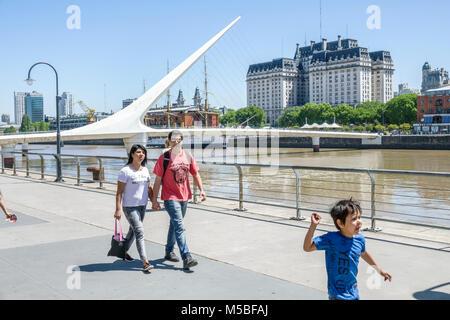 Buenos Aires Argentina Puerto Madero Rio Dique water riverfront city skyline Puente De La Mujer pedestrian suspension - Stock Photo