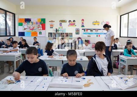 Pupils attend a Mayan mathematics class at Escuela Modelo primary school in Merida, Yucatan, Mexico on December - Stock Photo