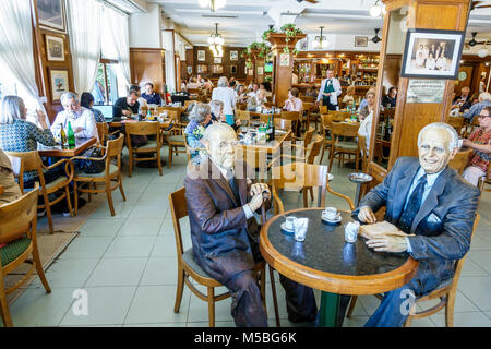Buenos Aires Argentina Recoleta La Biela Cafe historic cafe restaurant interior tables statues celebrity customers - Stock Photo