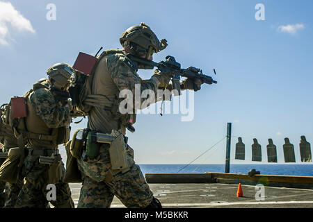 U.S. Marines with the Maritime Raid Force, 26th Marine Expeditionary Unit (MEU), engage targets with M4A1 Carbine - Stock Photo