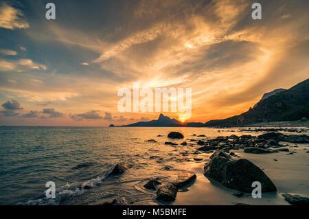 Sunset on mountain Love. View from Nhát beach. Con Dao island, Ba Ria, Vung Tau, Vietnam - Stock Photo