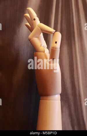 Wooden hand making the OK sign with a vintage background - Stock Photo