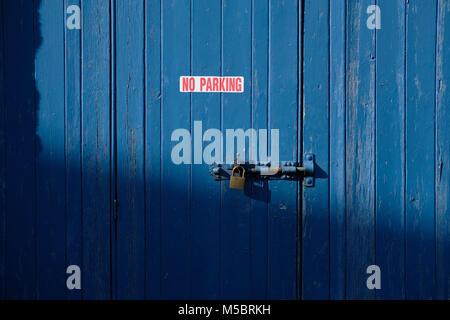 No parking sign on wooden door. - Stock Photo