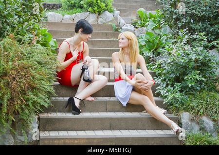 Girls talk about high heeled short MR slim thin fit slender slenderfit - Stock Photo