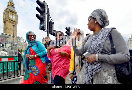London, England, UK. Group of muslim women talking in Parliament Square - Stock Photo