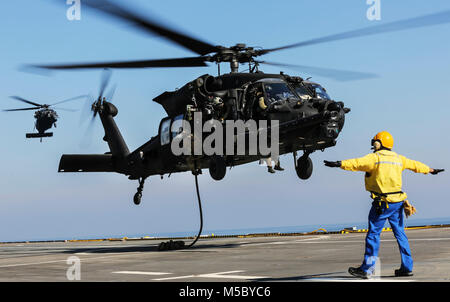 U.S. 5TH FLEET AREA OF OPERATIONS (Feb. 6, 2018) U.S. military forces fast rope out of an U.S. Army UH-60 Black - Stock Photo
