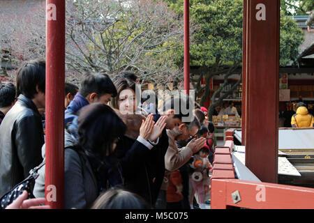 Pilgrims and tourists around Dazaifu Tenmangu, in Fukuoka. Taken in February 2018. - Stock Photo