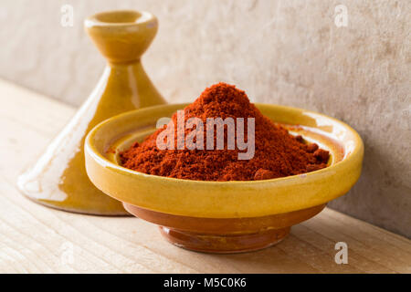Traditional yellow bowl with Moroccan dried ground paprika - Stock Photo