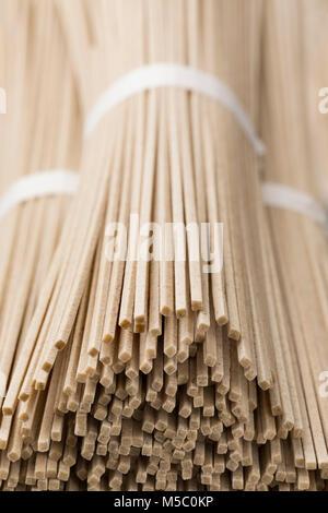 Japanese raw soba noodles bundles close up