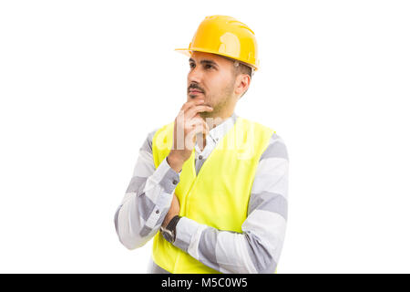 Visionary architect or engineer looking up and thinking about new projects. Wearing yellow hardhat and reflective - Stock Photo